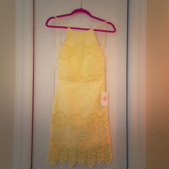 Yellow lacy dress ADORABLE never worn and still has the tags ! Sold out online. This would be the perfect Easter dress, spring/summer dress, or even graduation! Lulu's Dresses