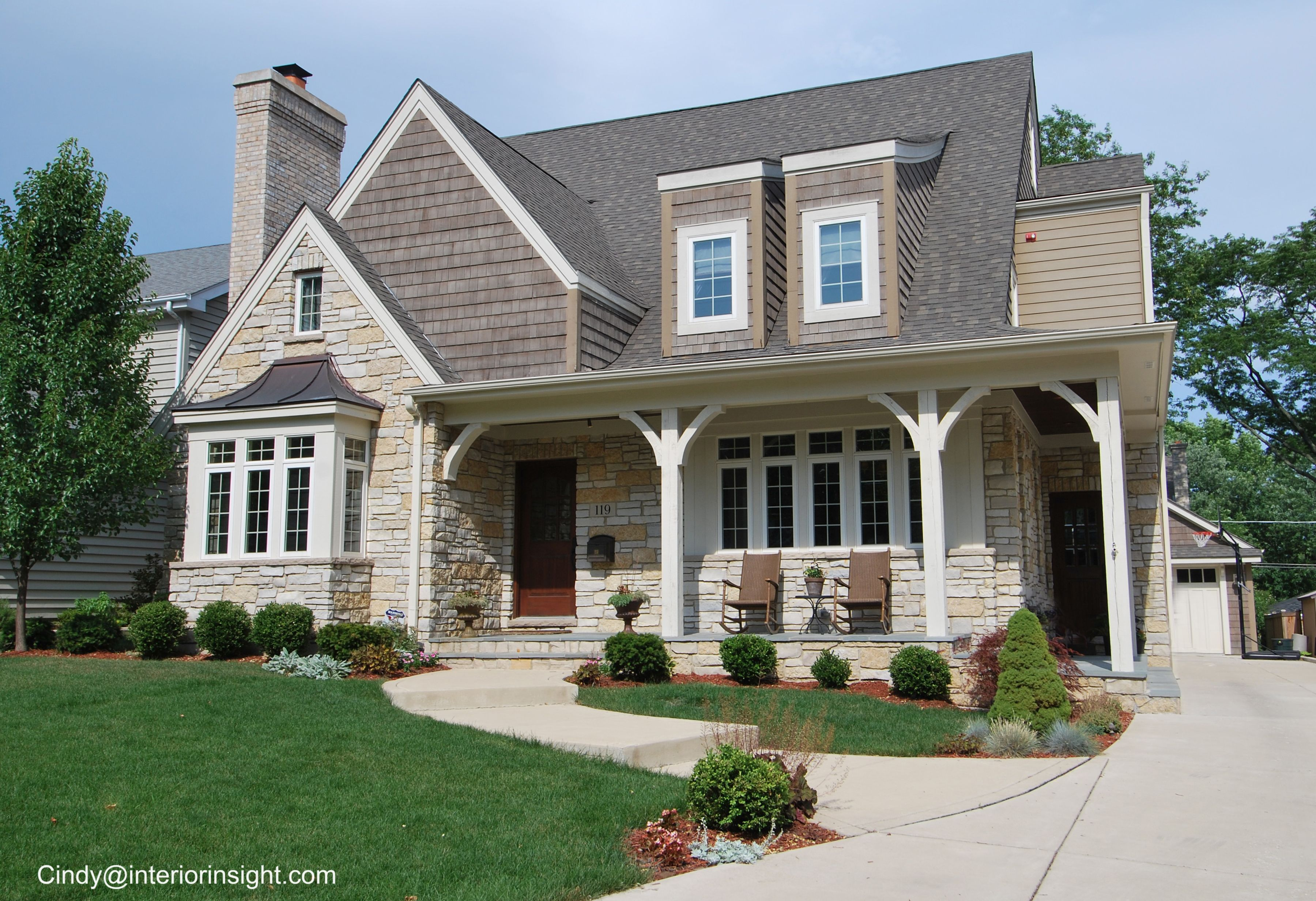 Stone front porch with cedar siding and wood door entry for Stone porches photos