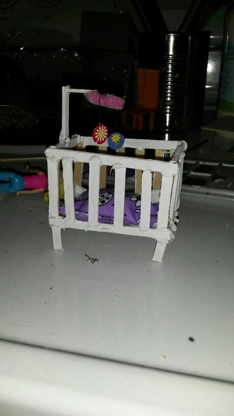 Baby Crib Made From Little Popsicle Sticks And A Piece Of Pipe Cleaner For Mobil