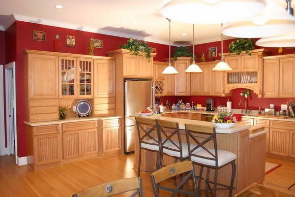 red walls w/oak cabinets, love the contrast! | interior decorating
