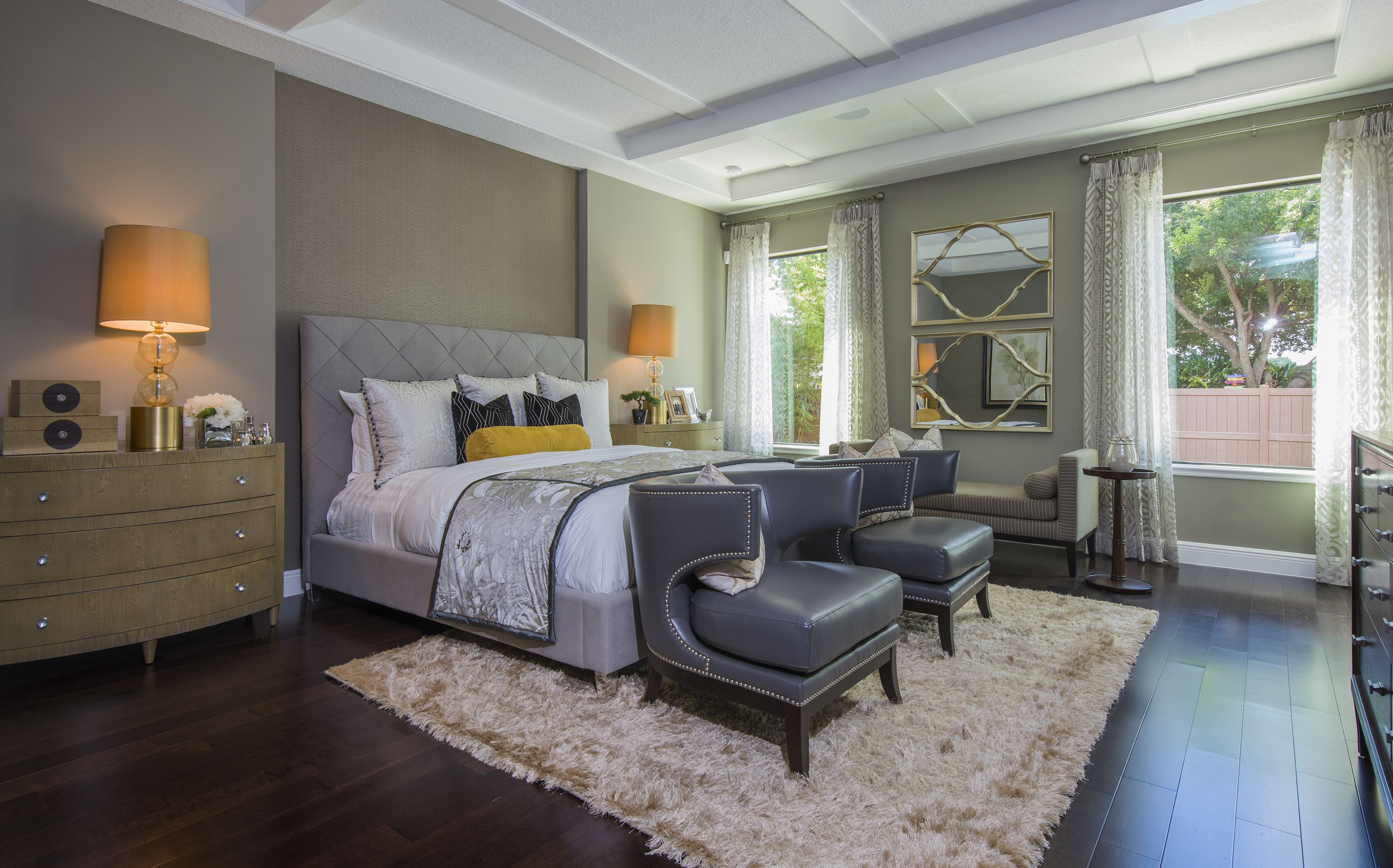 This sophisticated bedroom features a smoky range of ...