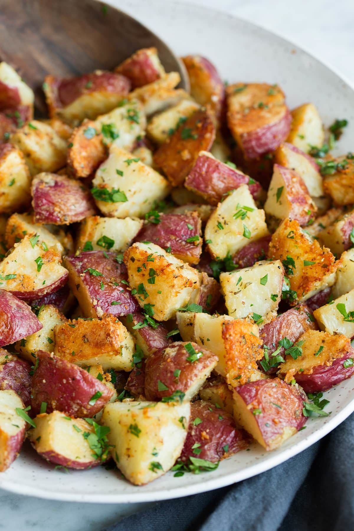 Roasted Potatoes With Parmesan Garlic And Herbs Cooking Classy Healthy Thanksgiving Recipes Cooking Herbs Herb Roasted Potatoes