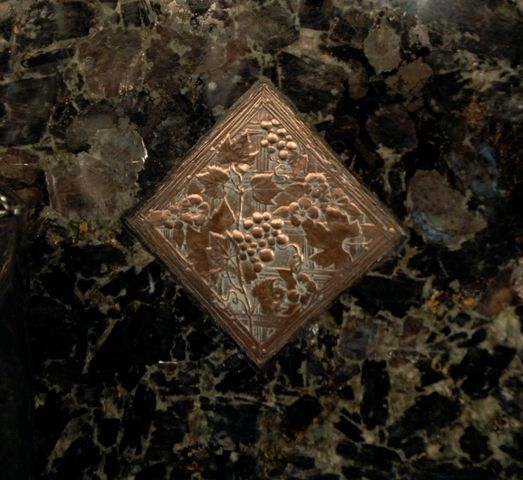 Volga Blue Granite Countertops with accented copper and ...