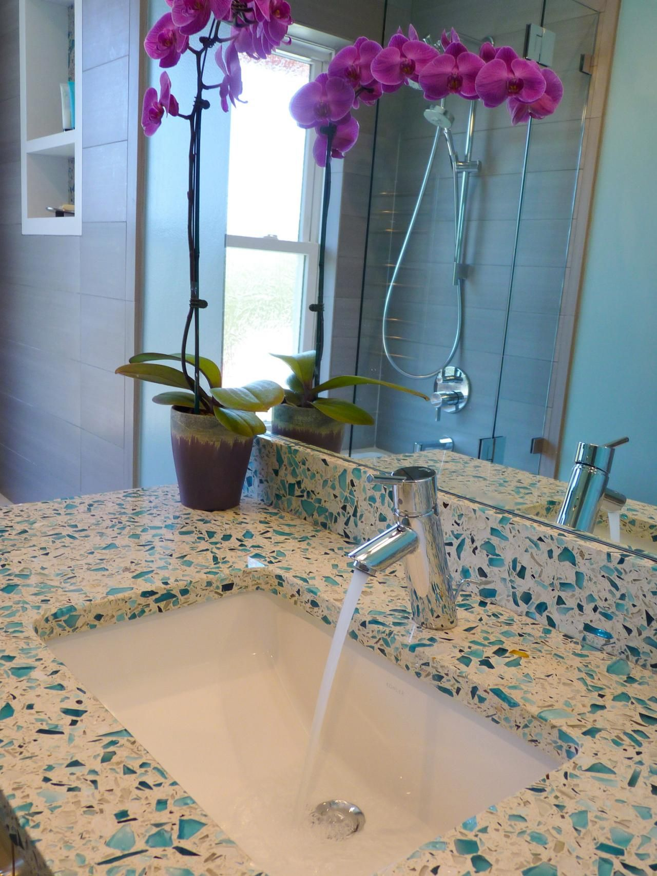 In This Caribbean Inspired Bathroom, Blues And Grays Are Used To Create A  Cool, Relaxed Atmosphere. The Unique Countertop Is Made From Recycled Glau2026