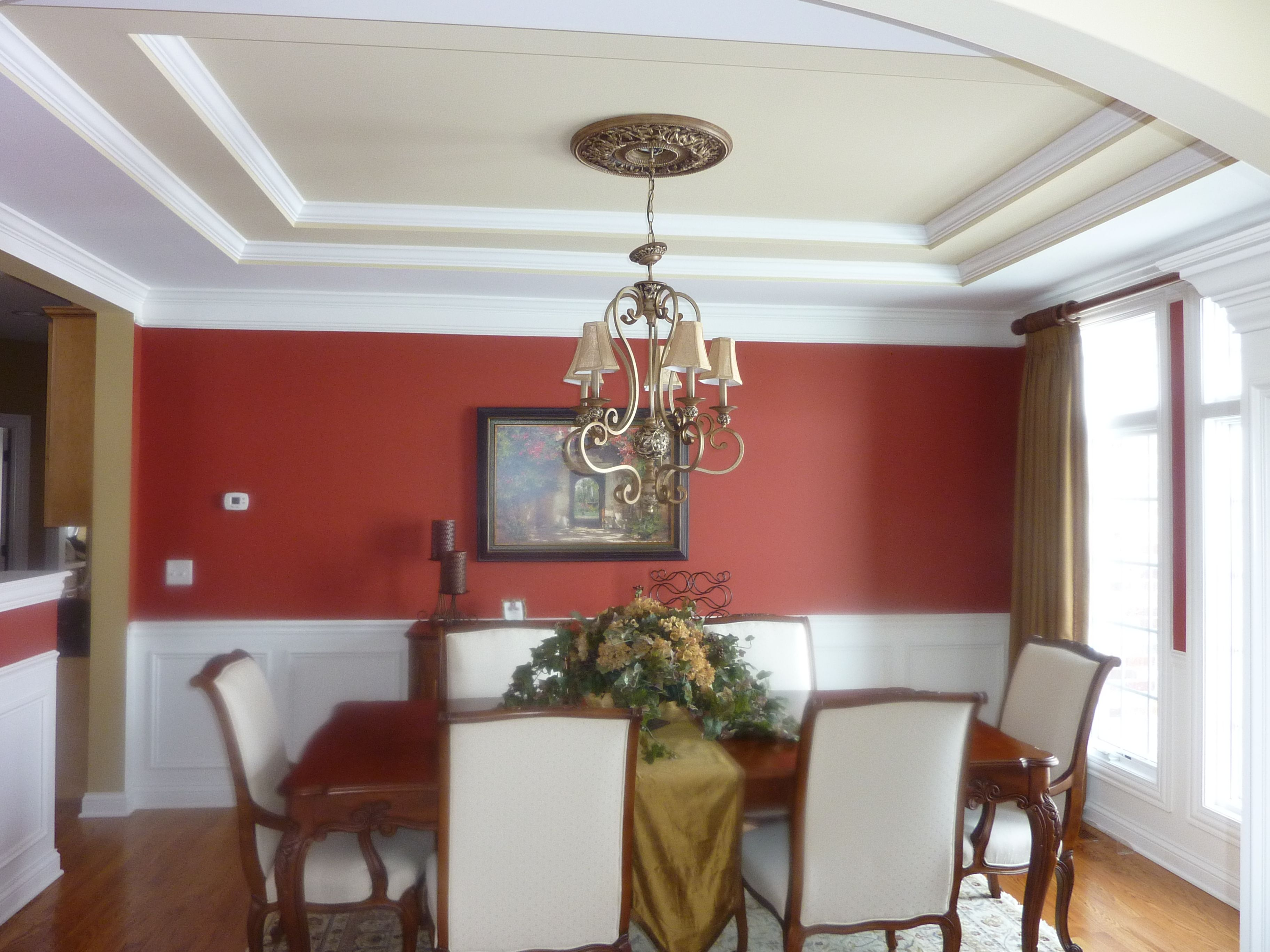 dinning room - maroon walls, dark wood stained trim, cream