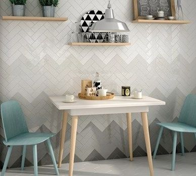 Subway Tiles Set In A Chevron Pattern Go From Dark To Light As They Move Up