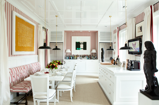 Red and white striped wall Banquette table live the art on the wall