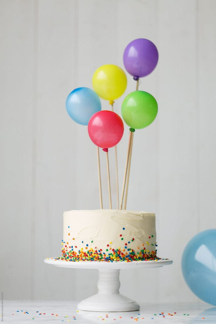 Birthday cake decorated with colorful balloons by