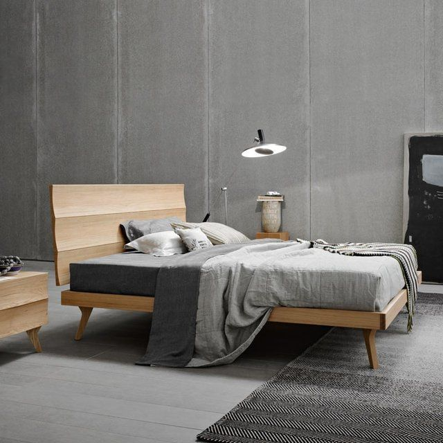 This elegant, minimal wood bed features a unique headboard. Headboard crafted with medium density post-formed panels with solid wood slats and oak veneer. Ring crafted with solid oak panels; solid oak legs. Please Note: Slats and mattress NOT included Overall: 178 l x 206/211/221 w x 102 cm h Bed frame: 160x195 cm; 160x200 cm; 160x210 cm. Please allow 3-5 weeks for shipping.