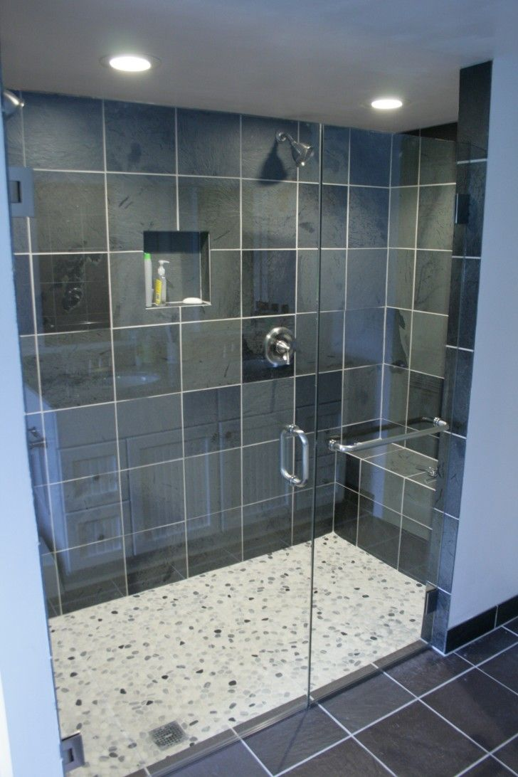 Interior. glass shower room with black wall tile and stainless ...