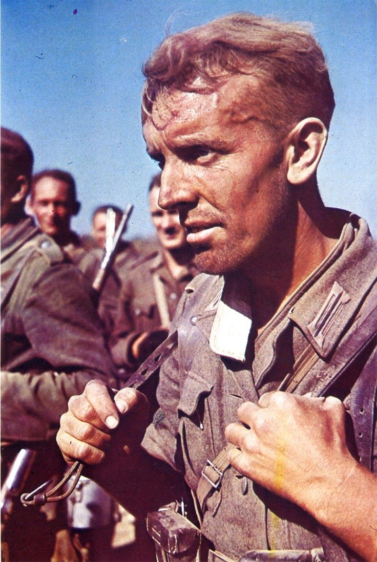 A color portrait of a German grenadier on the march in Russia in June 1941, shortly after the invasion.
