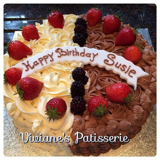 Half vanilla half chocolate rosette cake with fresh cream and fresh