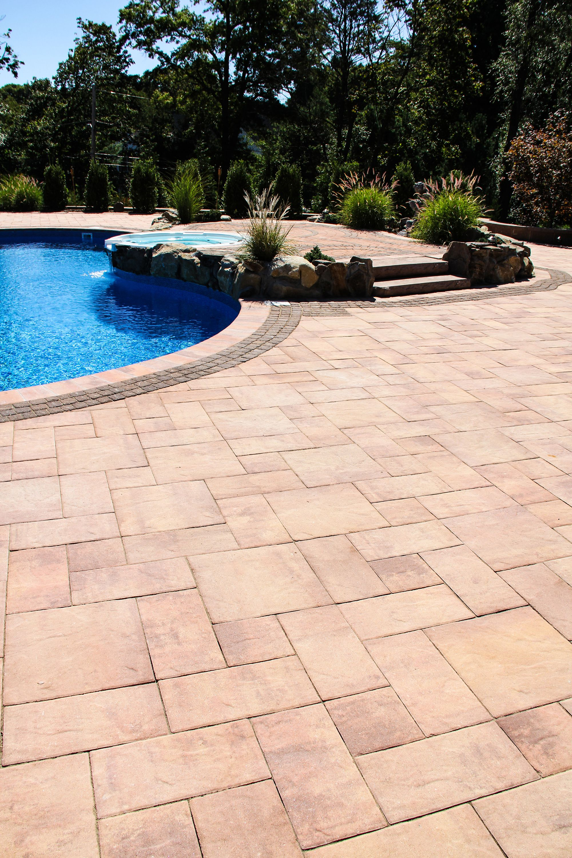 Pool And Hot Tub Surrounded By Our Stone Ridge Xl Collection In Crab Orchard Blend Nicolock Pavers Nicolock Pool Pavers Nicolock Pavers
