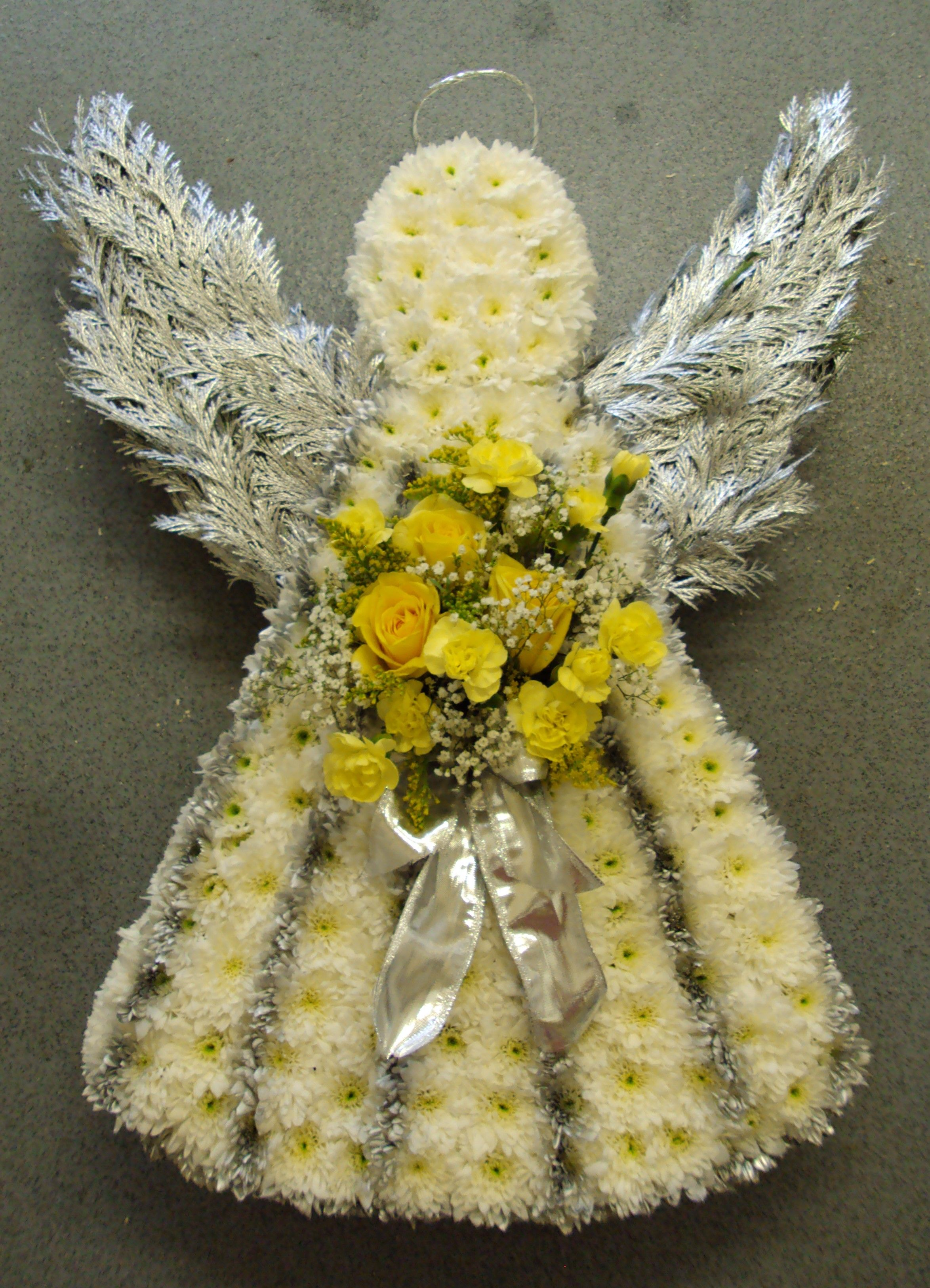 Angel with silver wings and yellow posy arrangement floral angel with silver wings and yellow posy arrangement izmirmasajfo