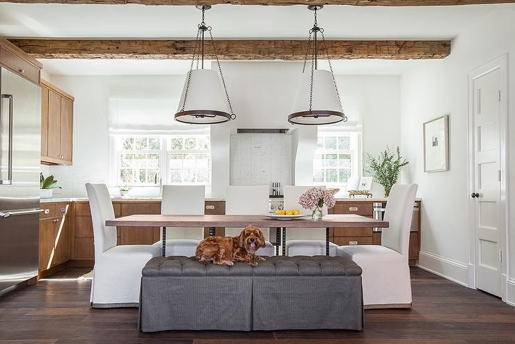Eat In Kitchen Boasts A Rustic Wood Beams On Ceiling Accented With Pair Of Cone