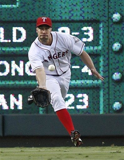 Texas Rangers left fielder David Murphy stretches to catch a fly ball hit by Minnesota Twins' Joe Mauer for the out during during the sixth inning of a baseball game, Saturday, July 7, 2012, in Arlington, Texas. The Rangers won 4-3. (AP Photo/LM Otero) game 85