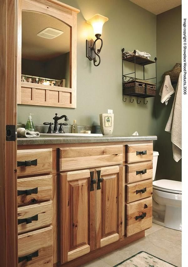 Showplace Wood Products Showplace Cabinetry Hickory Cabinets Nice Color Of Green On The Wal Light Green Bathrooms Green Bathroom Painting Bathroom Cabinets