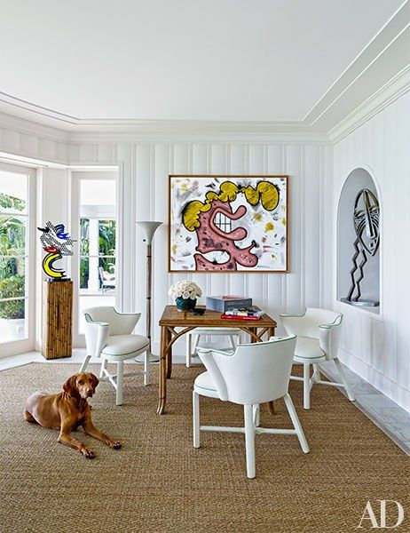 A bright Miami sunroom with statement pieces of art | archdigest.com