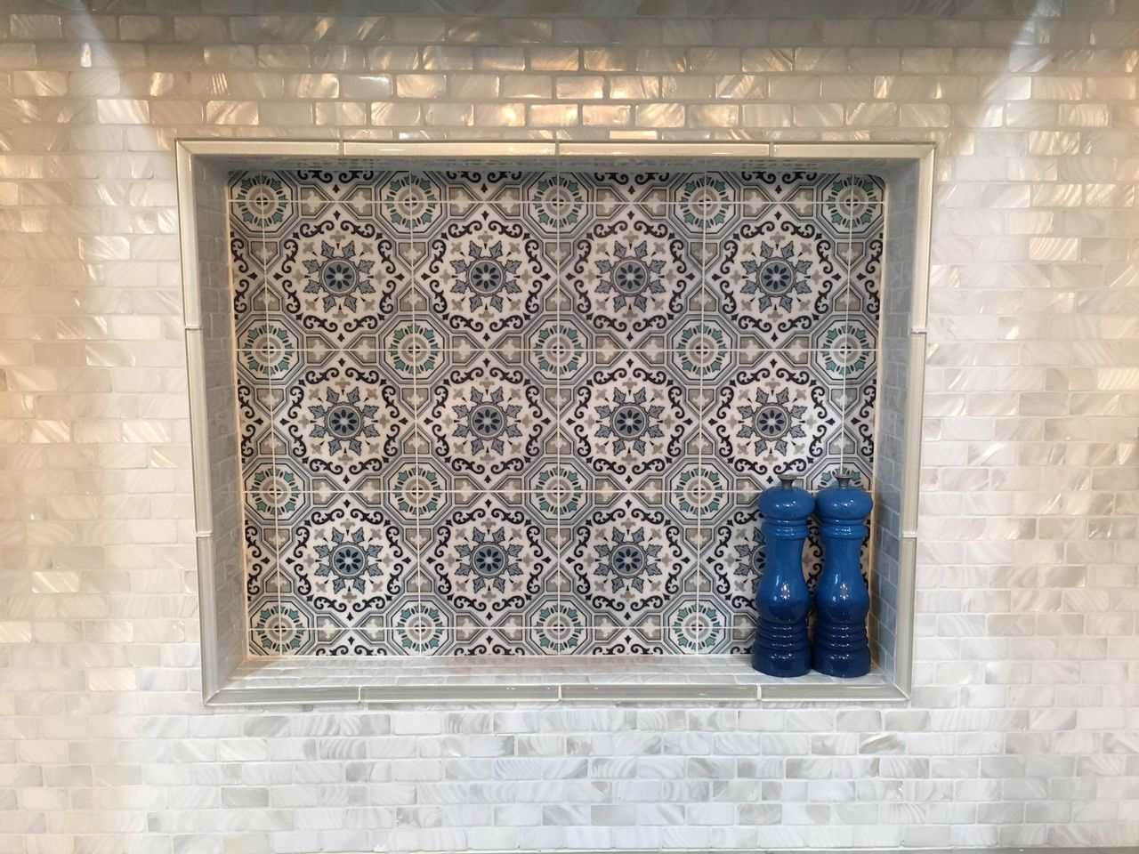 Stunning Hood/stove Backsplash Using White Brick Pearl Shell Tile With  Porcelain Tile Accent.