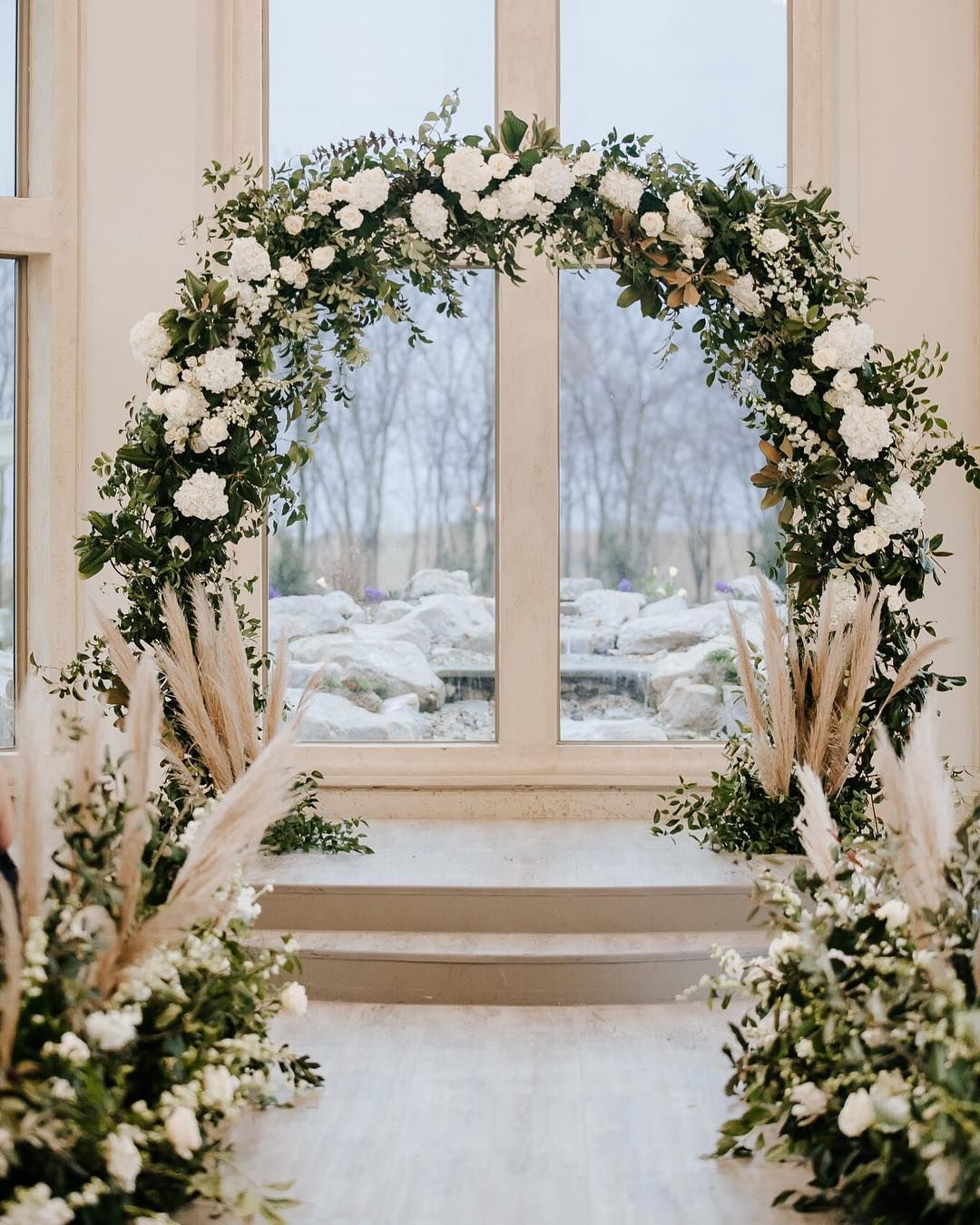 Lush Floral Arch At A Winter Wedding In Texas Wedding Arch Rental Arch Decoration Wedding Wedding Photo Walls