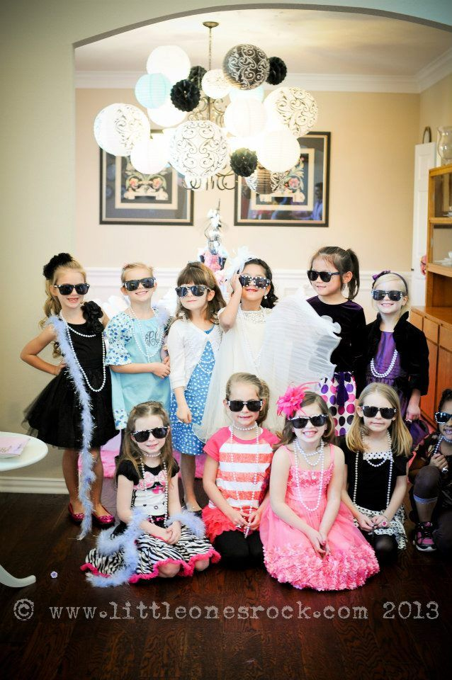 cute little girls birthday party with paris fashion show strike a