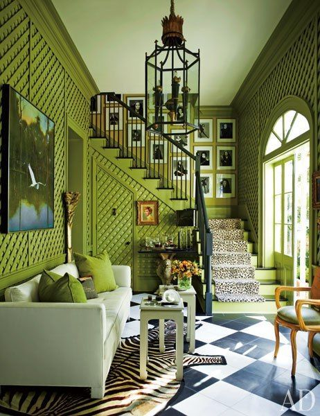 wonderful green lattice on walls, black/white floor, chandelier, lots of pictures on stairwell, cushy upholstery, lots of light Via:Mix and Chic