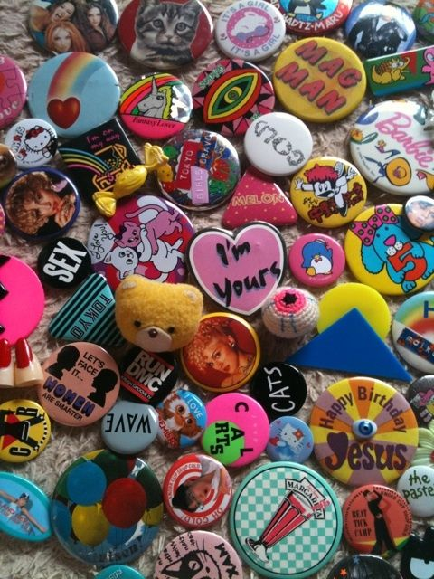 """buttons were an essential addition to the essential denim jacket. Unlike many of these buttons though, my buttons were mostly of bands I liked. Ha Ha, I just realized most young people probably don't know what I mean by """"band"""", I don't think we really call music groups bands much anymore these days, do we?"""