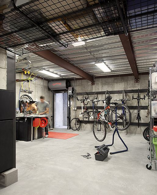 A Modern Family Home For Racing Bike Enthusiasts Sustainable Architecture With Warmth Texture Bike Storage Garage Garage Bike Overhead Garage Storage