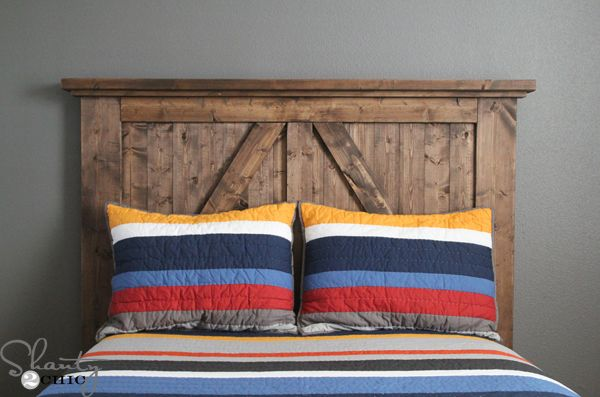 This barn door style headboard makes a rustic statement in one lucky boy's bedroom.