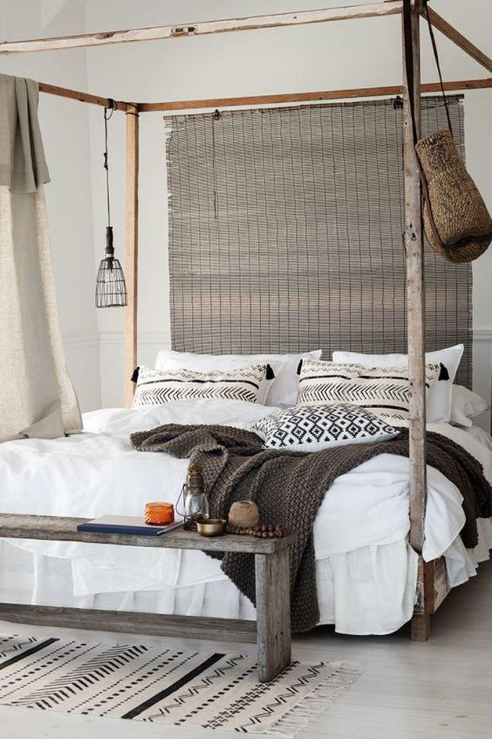 une chambre a coucher de style ethnique chic aux tons neutres lit baldaquin a inspiration africaine
