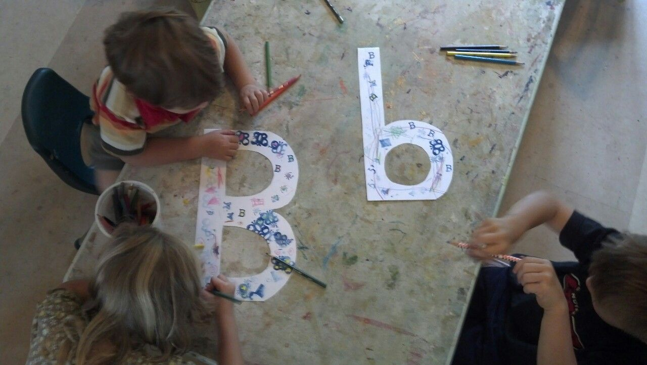 "Stamping and drawing ""B"" things on the letter B at preschool."