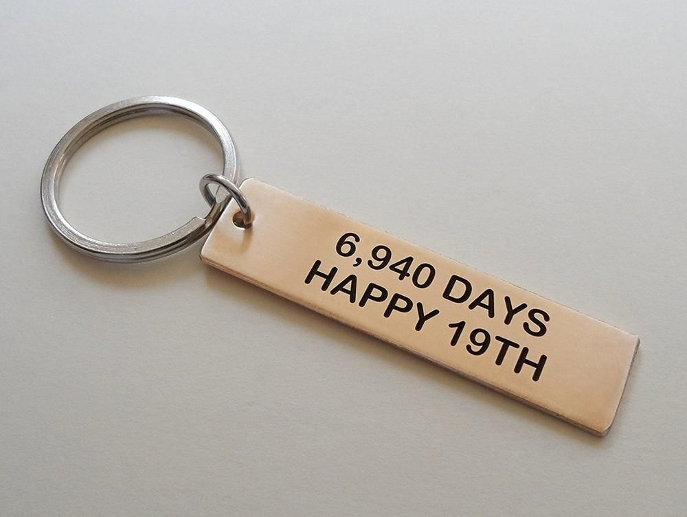 "Bronze Tag Keychain Engraved with ""6,940 Days, Happy 19th"