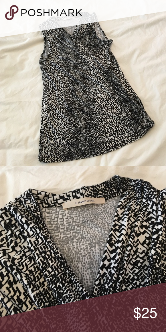 41 Hawthorn black and white sleeveless top. 41 hawthorn black and white sleeveless top. Size small. Never worn. Has rouching detail I left side. Great casual date night shirt but also looks excellent with a suit. 41 Hawthorne Tops Blouses