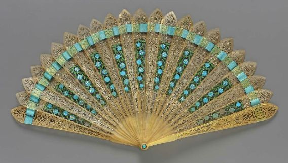 Brisé minuet fan with blue silk. Dutch, About 1810. In the Museum of Fine Arts Boston.