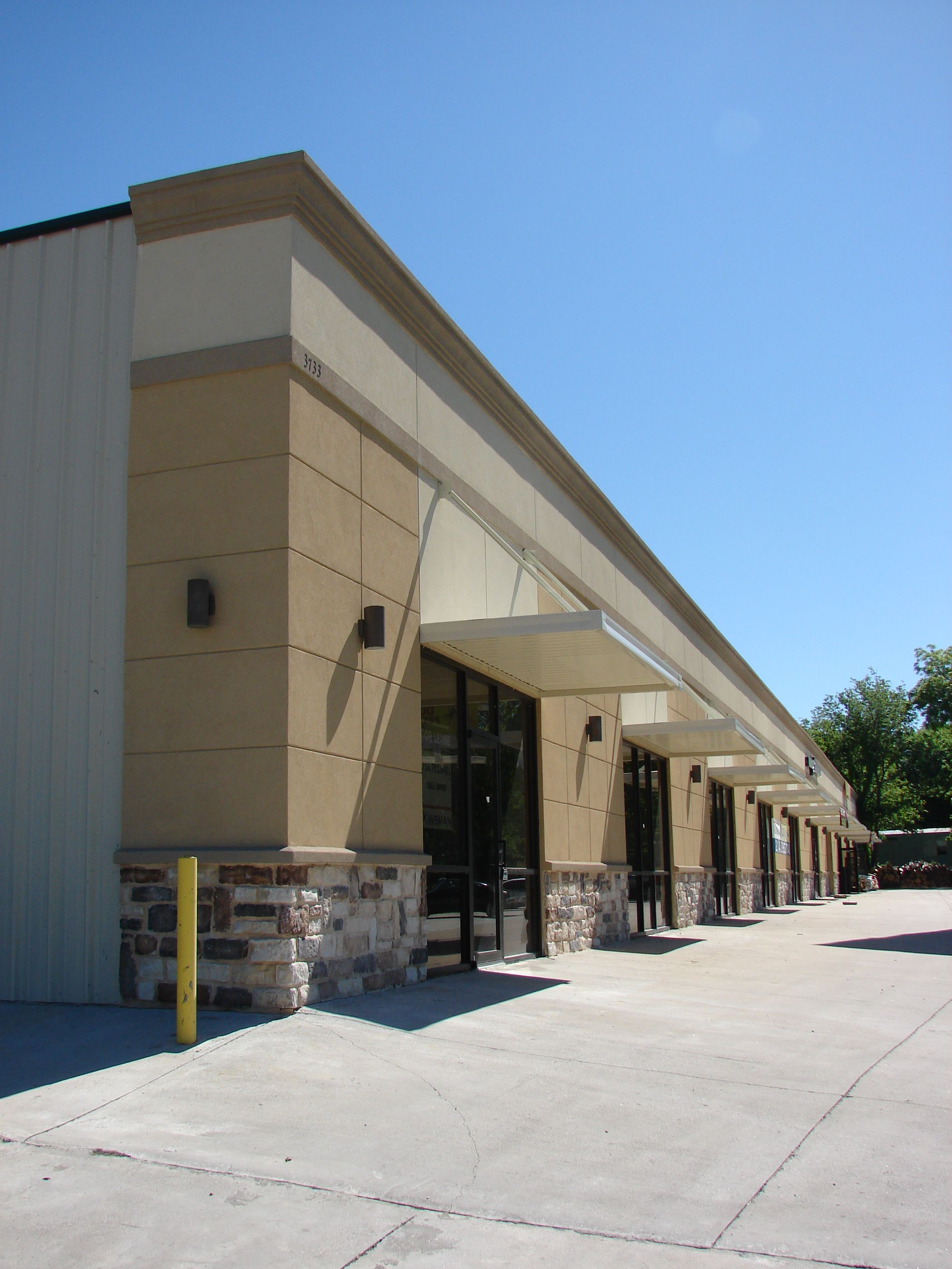 Strip mall application of a steel building for retail for Retail building plans