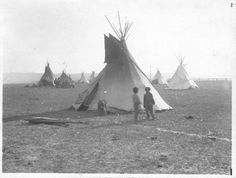 Three Children in Front of a Tipi by The U.S. National Archives, via Flickr
