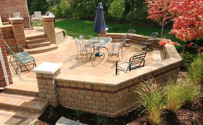 Raised Stone Tile Patio With Seatwall And Columns