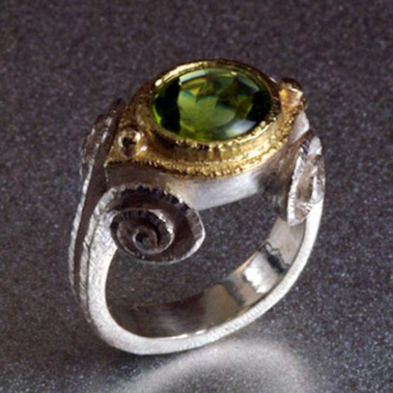 NADINE KARIYA - Peridot spiral ring in sterling silver, 18k gold, and 3 carat peridot.