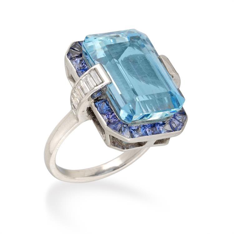 An aquamarine, sapphire and diamond cluster ring - Bentley & Skinner
