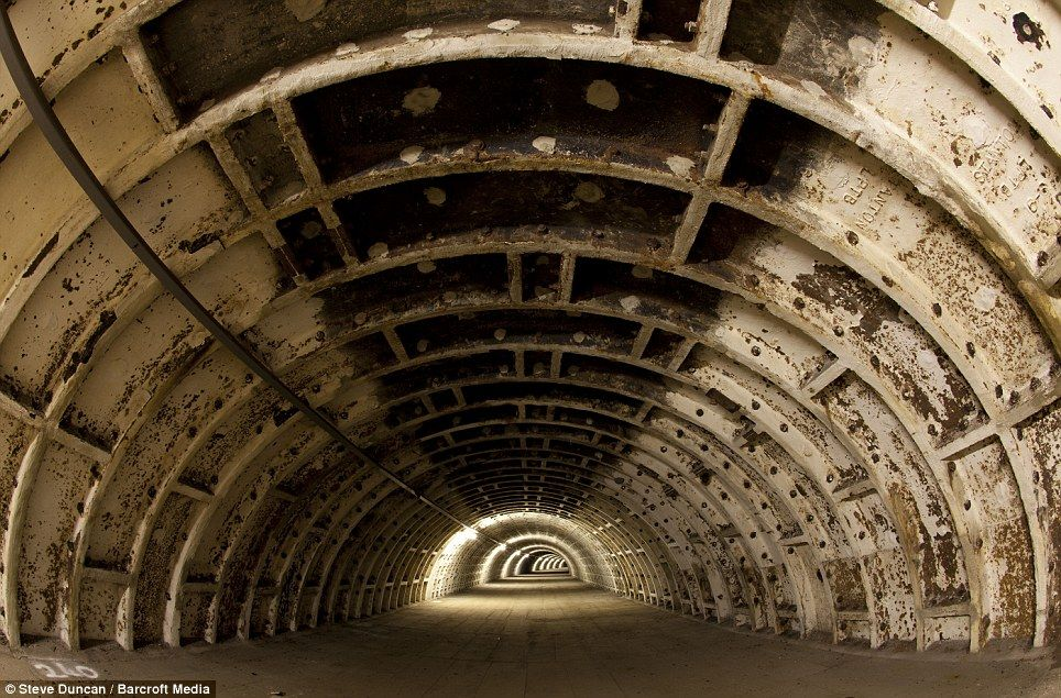 Hidden gems: A tunnel used for storage under Clapham North underground station in London Mr Duncan said he found spaces like this 'totally unused and lonely'