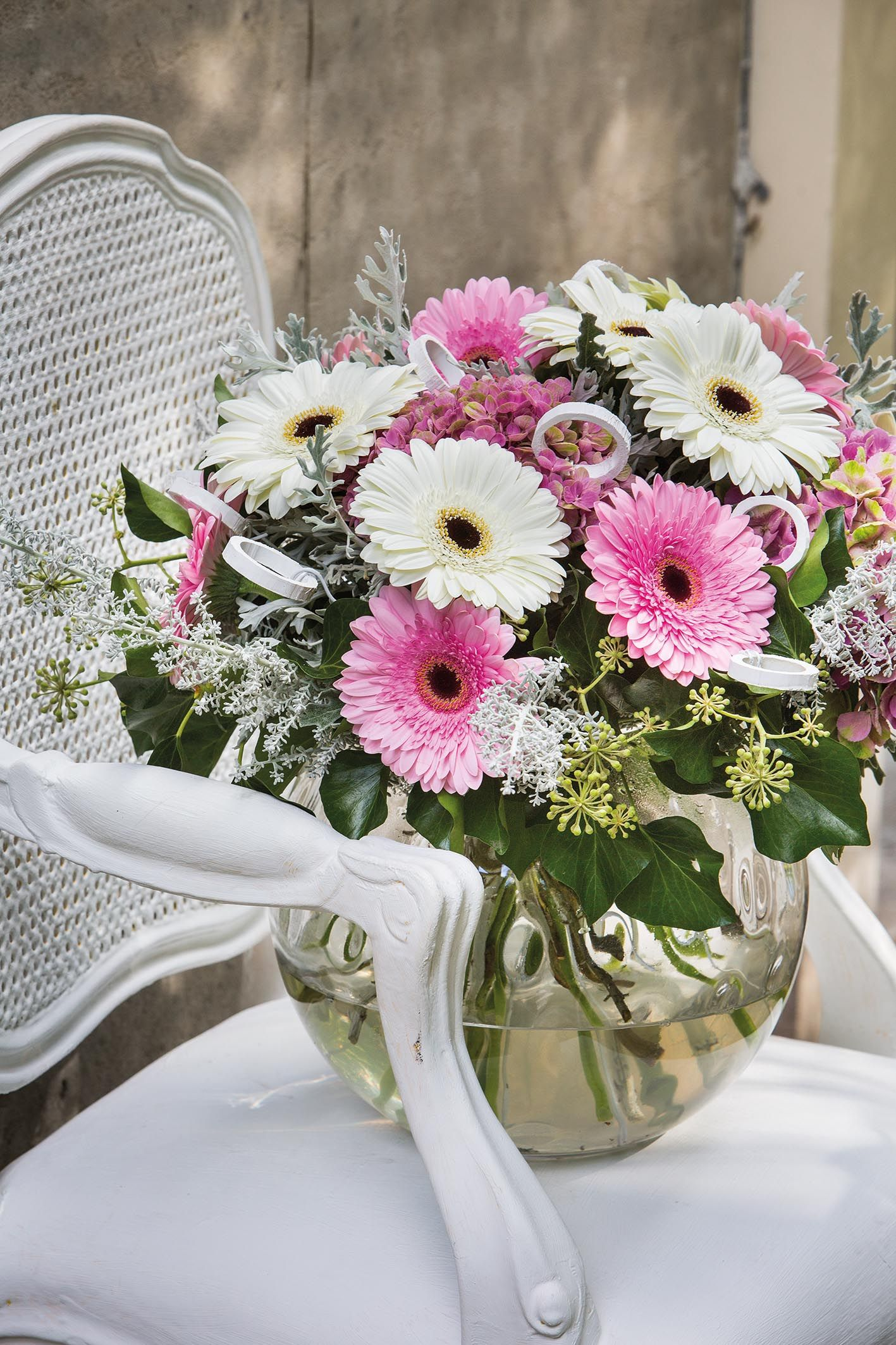 Tiny colourful gerbera bouquet on a white chair #pinkgerberas ...