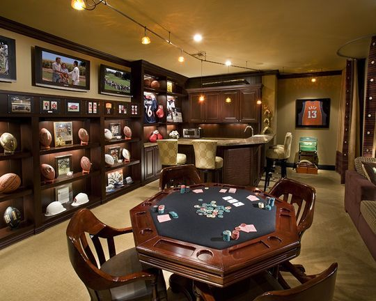 Memorabilia Is Displayed In Custom Designed Cabinetry With Zenon Lighting Magnetic Acrylic Panels At The Top Of T Man Cave Room Man Cave Design Best Man Caves