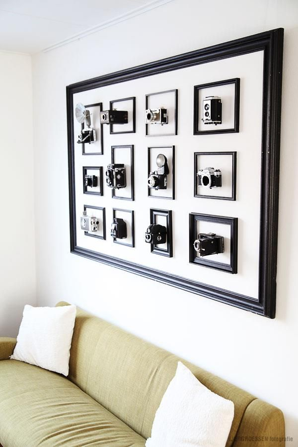 A collection of 12 vintage camera\'s inside frames, which are ...