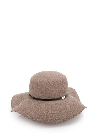 c084b0fca255 Beige wool wide-brimmed hat by Gucci with black leather strap and gold tag  with engraved logo.