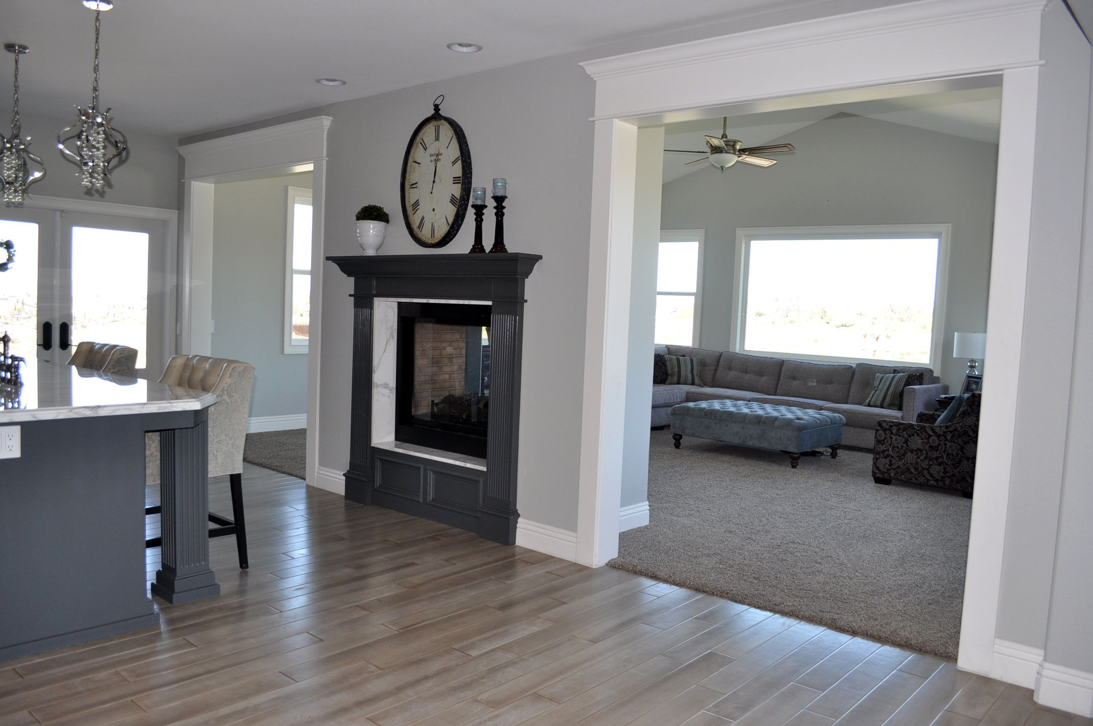 Grey Hardwood Floors and doublesided fireplace