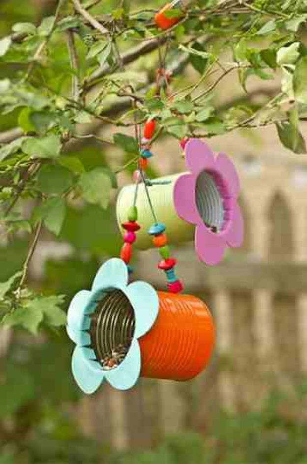 35 DIY Bird Feeders You Will Want To Make Immediately is part of Tin can flowers, Diy bird feeder, Diy birds, Homemade bird feeders, Bird houses diy, Bird feeders - Love looking out the window into your backyard  Perhaps you have a lovely view that includes lots of cool DIY patio and backyard decor  Perhaps you have nothing but are looking for just that, some creative ideas for DIY projects that add some interest to that view  Either way, we think you should add a DIY bird feeder to your list of musthave decor ideas for the yard, porch or patio  Not only do these look incredible, they are inexpensive, most are easy to make, and they will attract some feathered friends for you to start watching  Once I added