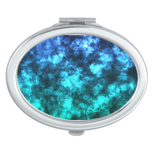 Blue and aqua sea green mix in a festival of lights in this bokeh light digital art piece.