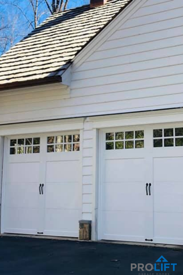 Carriage House Garage Doors Clopay Coachman Insulated Low Maintenance In 2020 Garage Door Styles Carriage House Doors Carriage House Garage Doors