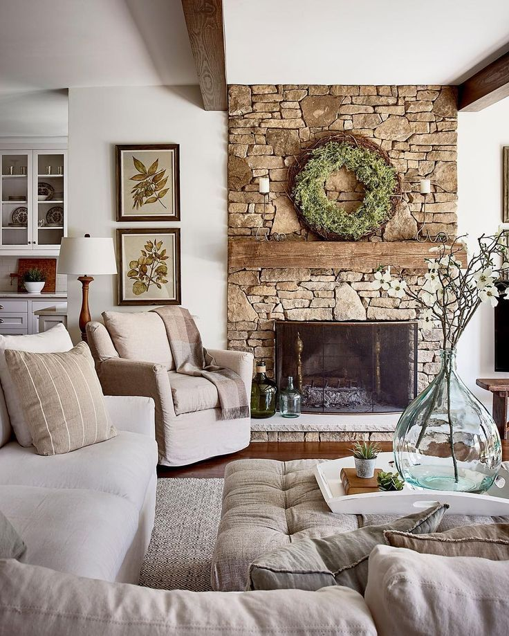 rustic farmhouse family room design and stone fireplace