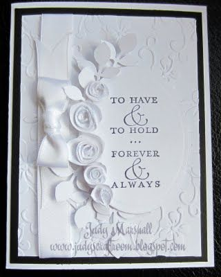 elegant all white wedding card with rolled roses...excellent tutorial on the blog...